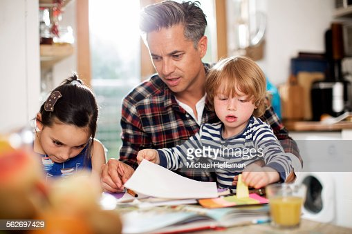 Father doing art with son and daughter