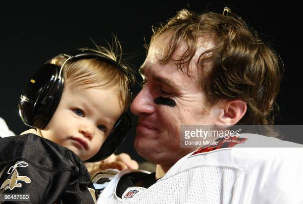 Father Drew Brees of the New Orleans Saints celebrates with his son Baylen Brees after defeating the Indianapolis Colts during Super Bowl XLIV on...