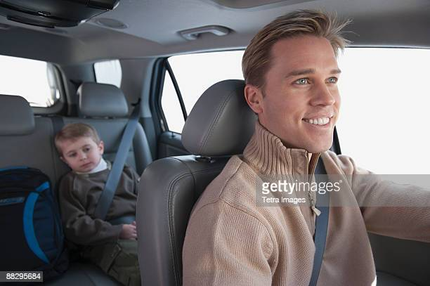 Father driving son to school