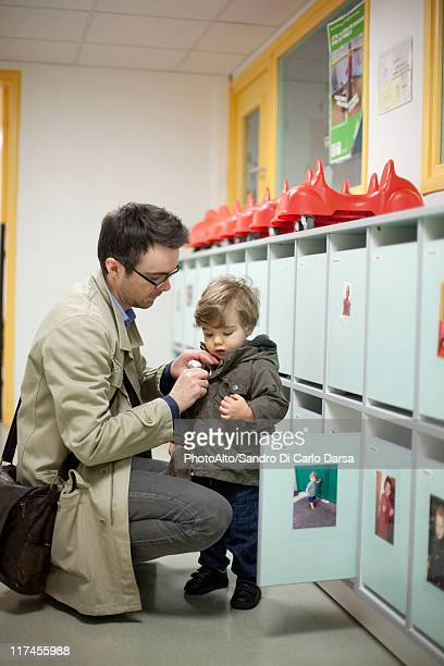 Father dropping toddler son off at preschool