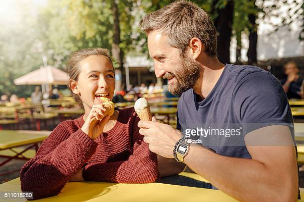father eating ice cream with daughter