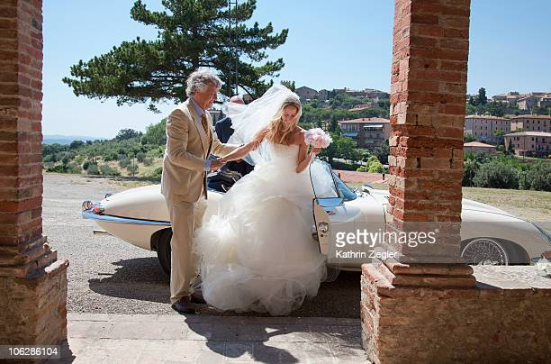 father escorts bride to the church