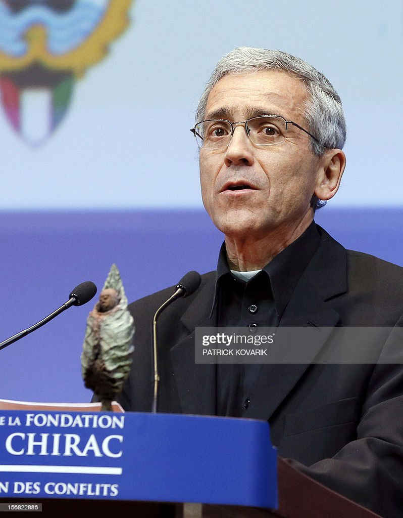 Father Francisco de Roux delivers a speech after awarding for the prize for conflict prevention during the ceremony of release of the Jacques Chirac Foundation's 2012 Award for the prevention of conflicts, on November 22, 2012 at the Quai Branly Museum in Paris.