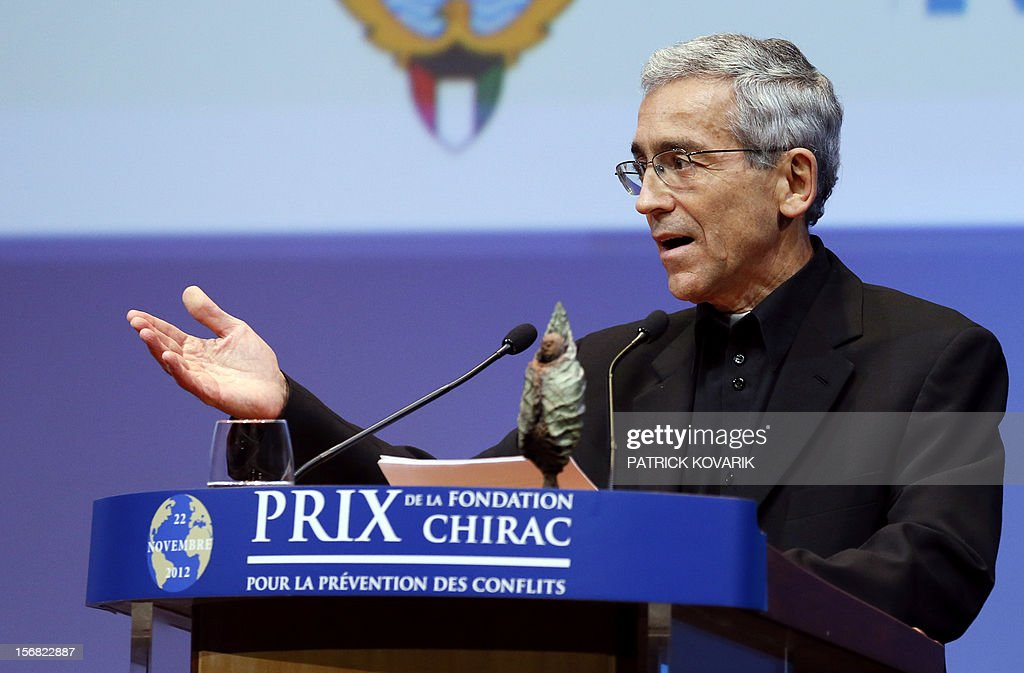 Father Francisco de Roux delivers a speech after awarding for the prize for conflict prevention during the ceremony of release of the Jacques Chirac Foundation's 2012 Award for the prevention of conflicts, on November 22, 2012 at the Quai Branly Museum in Paris. AFP PHOTO PATRICK KOVARIK
