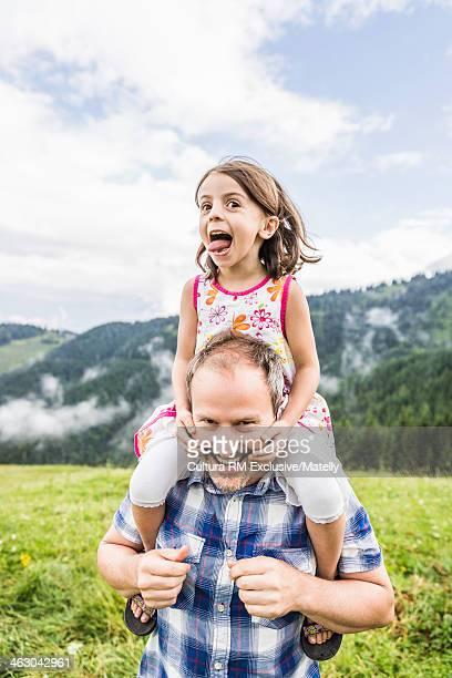 Father giving daughter shoulder ride, Tyrol, Austria