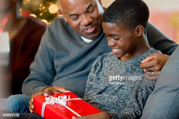 Father Giving His Son a Gift