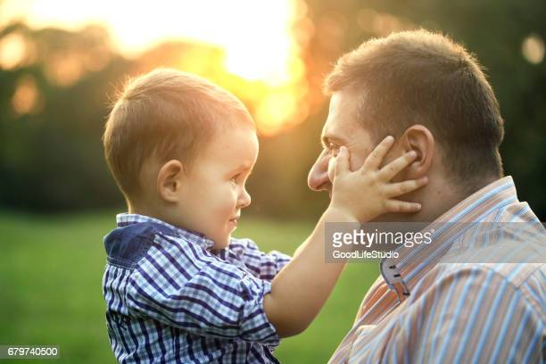 Father having fun with his son