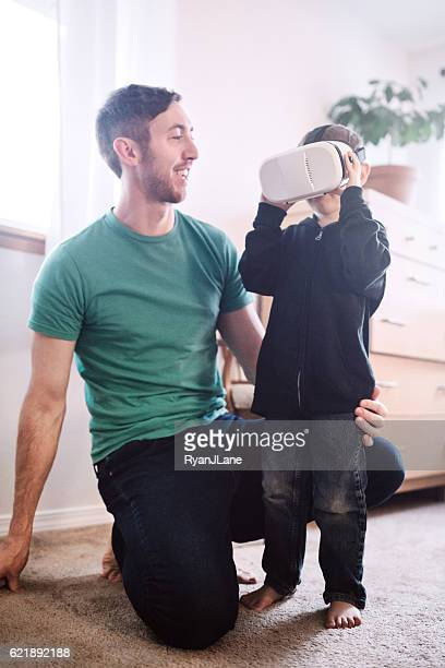 Father Helps His Son With VR Headset