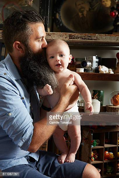 Father holding and kissing baby