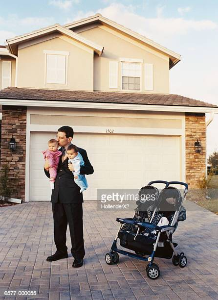Father Holding Babies