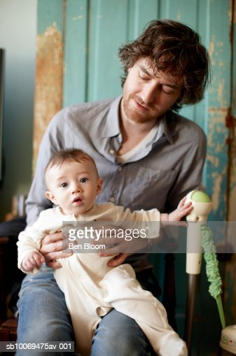 Father holding baby boy (6-11 months), close-up : Stock Photo