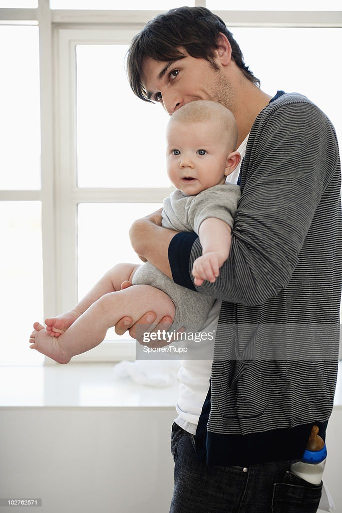Father holding baby boy : Stock Photo