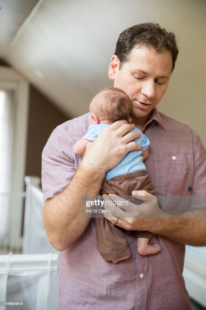 Father holding baby : Stock Photo