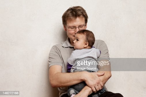 Father holding baby son : Stock Photo