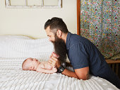 Father holding baby's feet