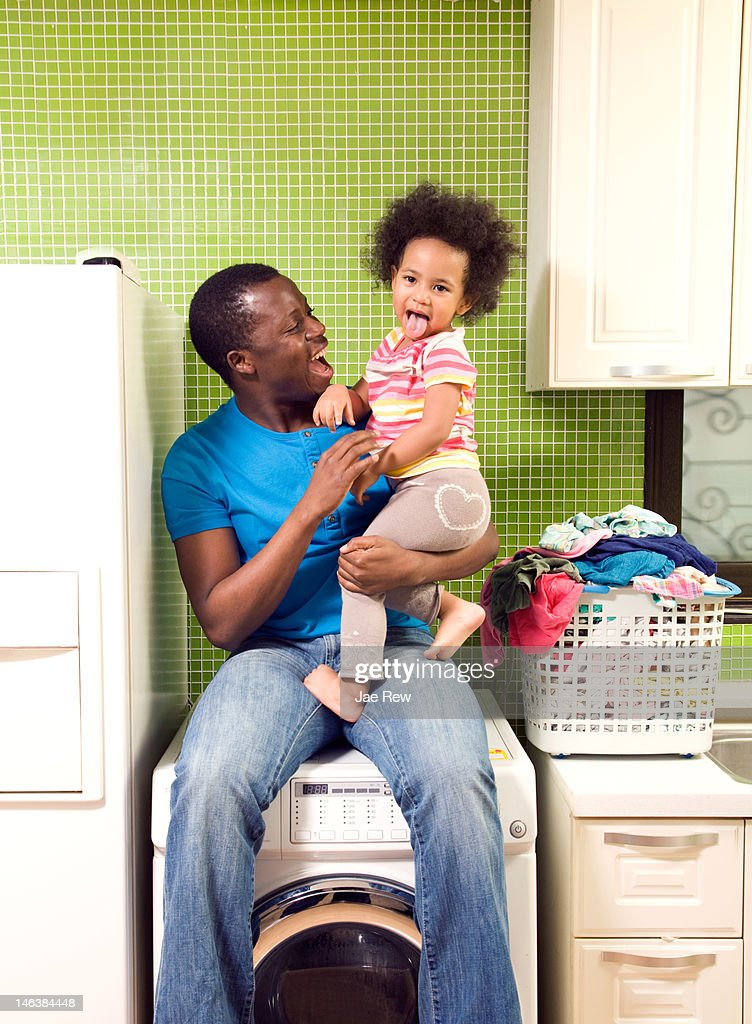 Father holding daughter and laugh : Stock Photo