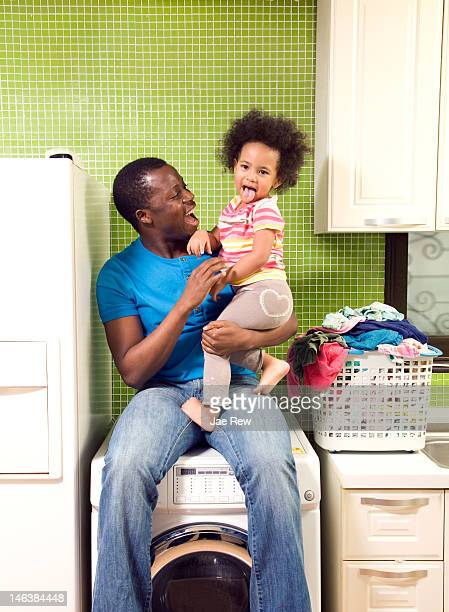 Father holding daughter and laugh