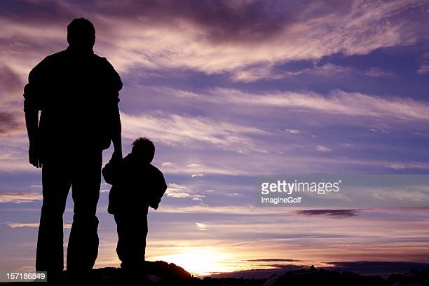 Father Holding Hands With Child Silhouette