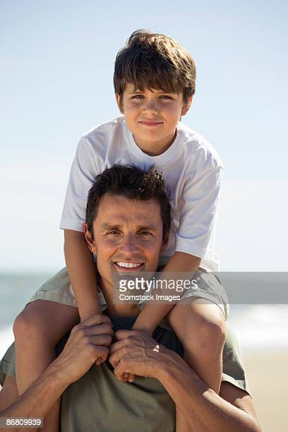 Father holding his son on his shoulders