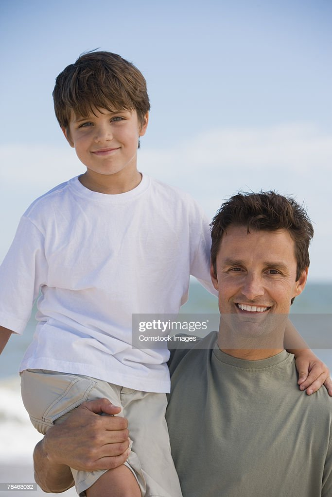 Father holding son on his shoulder : Stock Photo