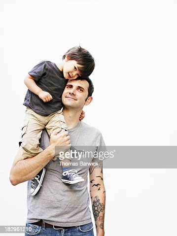 Father holding son on shoulder