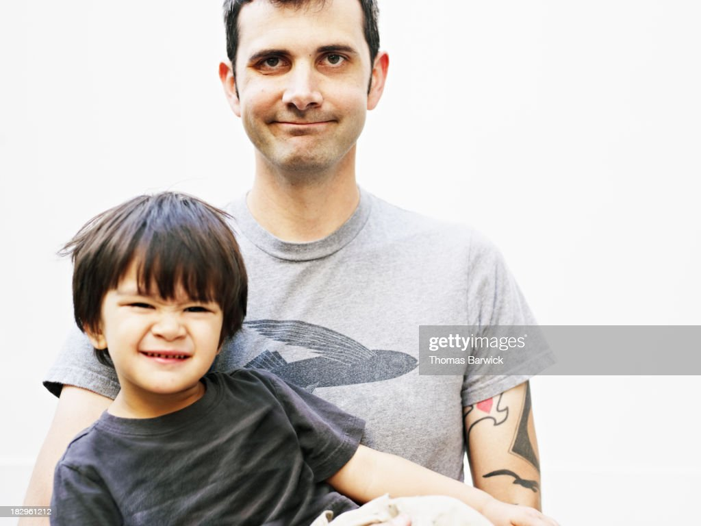 Father holding son