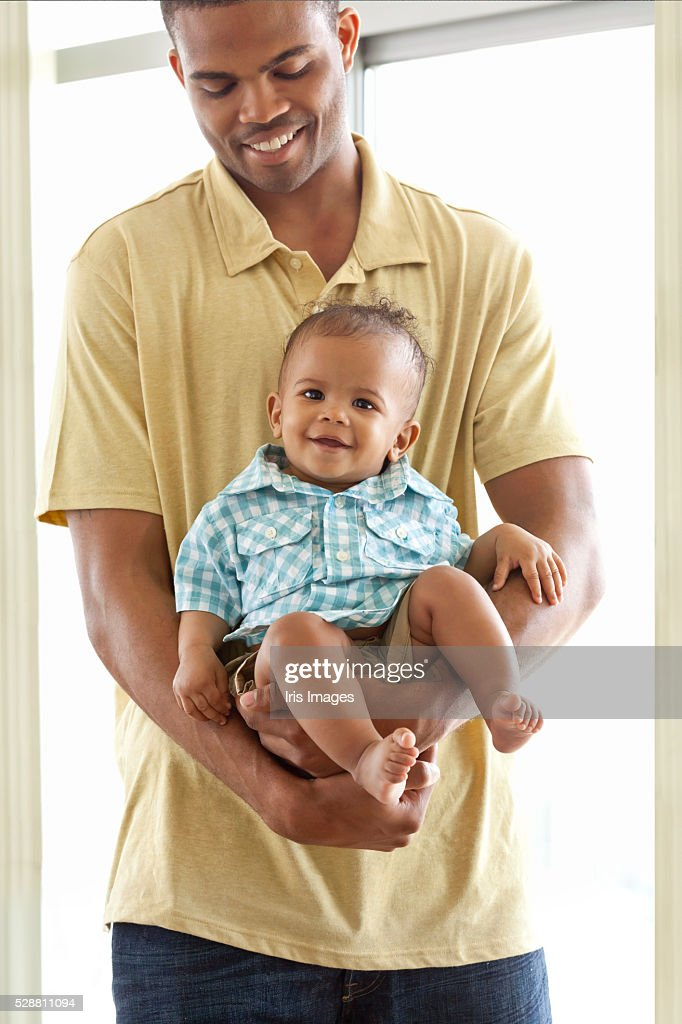 Father holding son (6-12 months)
