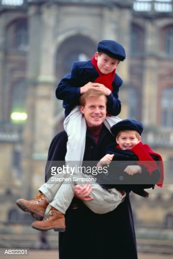 Father holding sons (5-7), portrait : Stock Photo