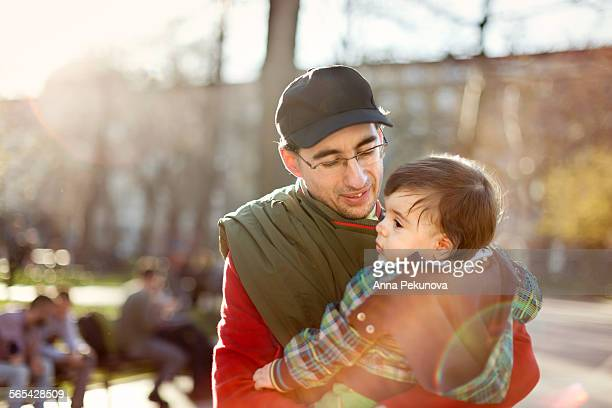 Father holding toddler boy