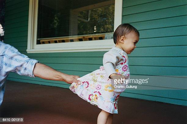 Father Holding Toddlers Dress