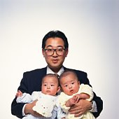 Father holding twins baby boys