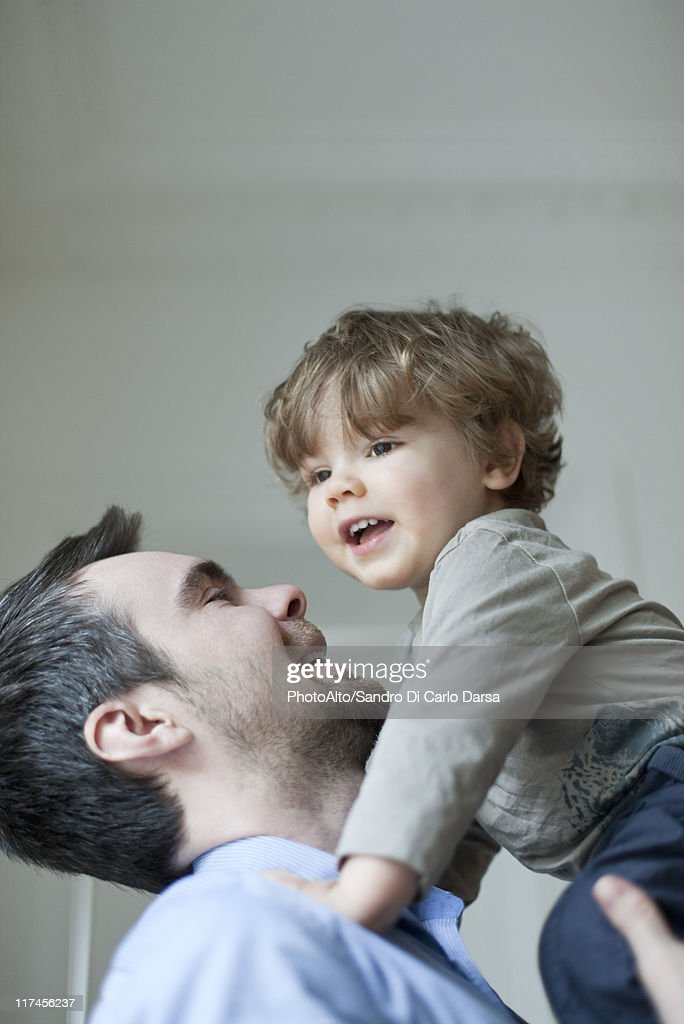 Father holding up young son, portrait : Stock Photo