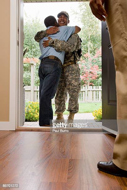 Father Hugging Returning Soldier