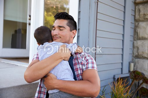 Father Hugging Son Sitting On Steps Outside Home : Stock-Foto