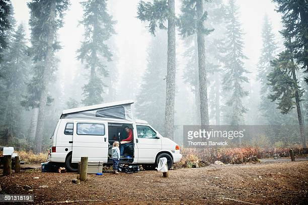Father in camper in discussion with daughter