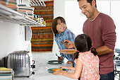 Father in kitchen with children (6-10)