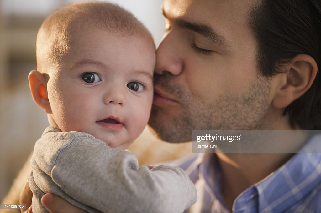 Father kissing baby boy : Stock Photo