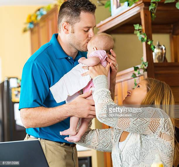 Father kissing daughter before leaving home for work