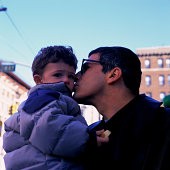 Father Kissing His Son on a New York City Street