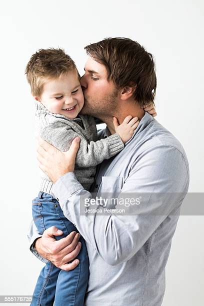 Father kissing son (2-3)