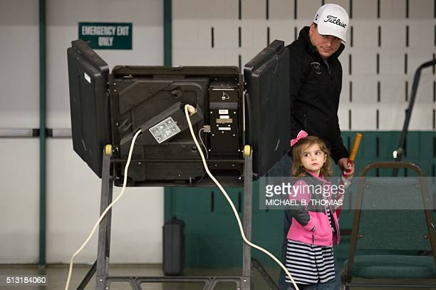 A father leaves with his daughter after casting his ballot at the McGee Community Center on March 1 2016 in Conway Arkansas Americans began voting in...
