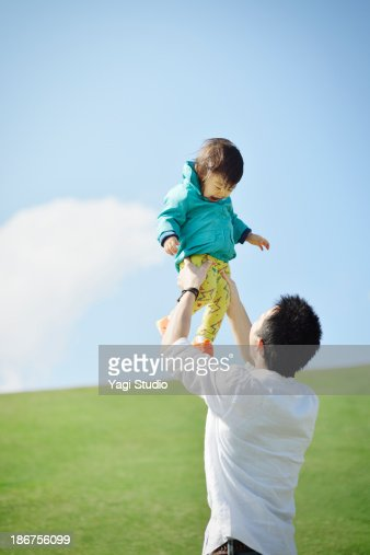 Father lifting daughter mid air : Stock Photo