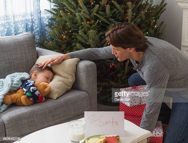 Father looking after boy (6-7) during sleep, Jersey City, New Jersey, USA