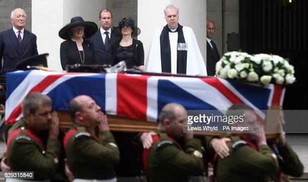 father Major John Thorneloe mother Veronica Casualty Visiting Officer Major Nigel Overton wife Sally Thorneloe and Senior Chaplain Paul Wright watch...