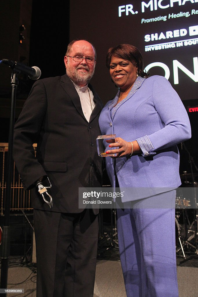 Father Michael Lapsley (L) and Dr. Suzan Johnson Cook pose onstage at the Shared Interest 19th Annual Awards Gala on March 18, 2013 in New York City.