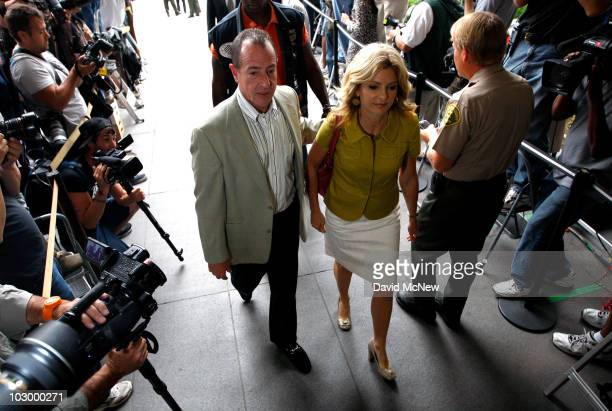 Father Michael Lohan and lawyer Lisa Bloom arrive at the Beverly Hills Courthouse to witness Lindsay Lohan surrender to serve her 90 day jail...