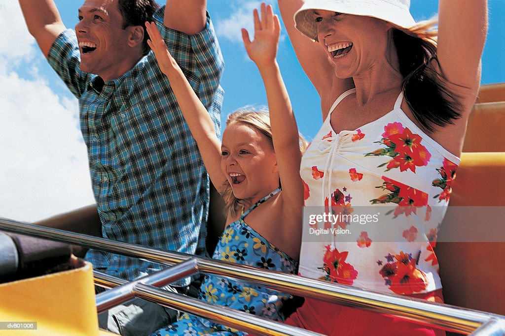 Father, Mother and Daughter on a Rollercoaster Ride : Stock Photo