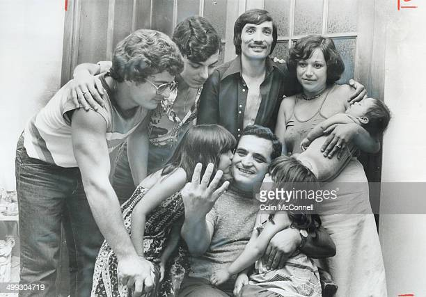 Father of quadruplets Giuseppe Denardo 41 is congratulated by family members From left foreground clockwise Pina Rizzo Joe Mangiardi Sal Denardo...