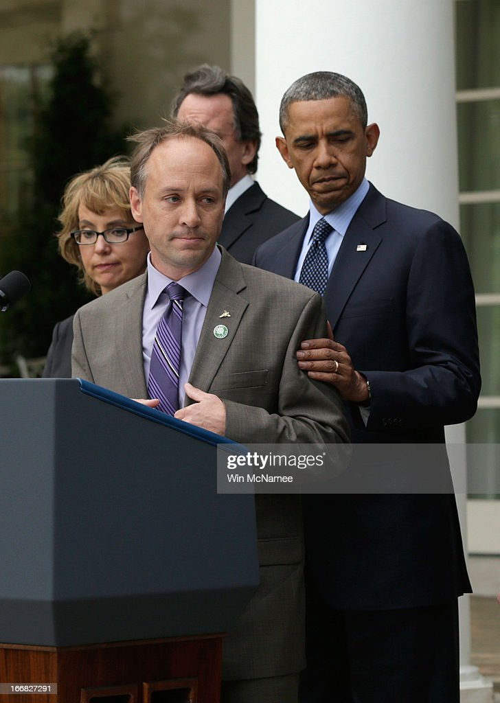 Father of Sandy Hook Elementary School shooting victim, Mark Barden introduces U.S. President <a gi-track='captionPersonalityLinkClicked' href=/galleries/search?phrase=Barack+Obama&family=editorial&specificpeople=203260 ng-click='$event.stopPropagation()'>Barack Obama</a> (R) as former U.S. Rep. <a gi-track='captionPersonalityLinkClicked' href=/galleries/search?phrase=Gabrielle+Giffords&family=editorial&specificpeople=6961081 ng-click='$event.stopPropagation()'>Gabrielle Giffords</a> (L) looks on in the Rose Garden of the White House on April 17, 2013 in Washington, DC. Earlier today the Senate defeated a bi-partisan measure to expand background checks for gun sales.