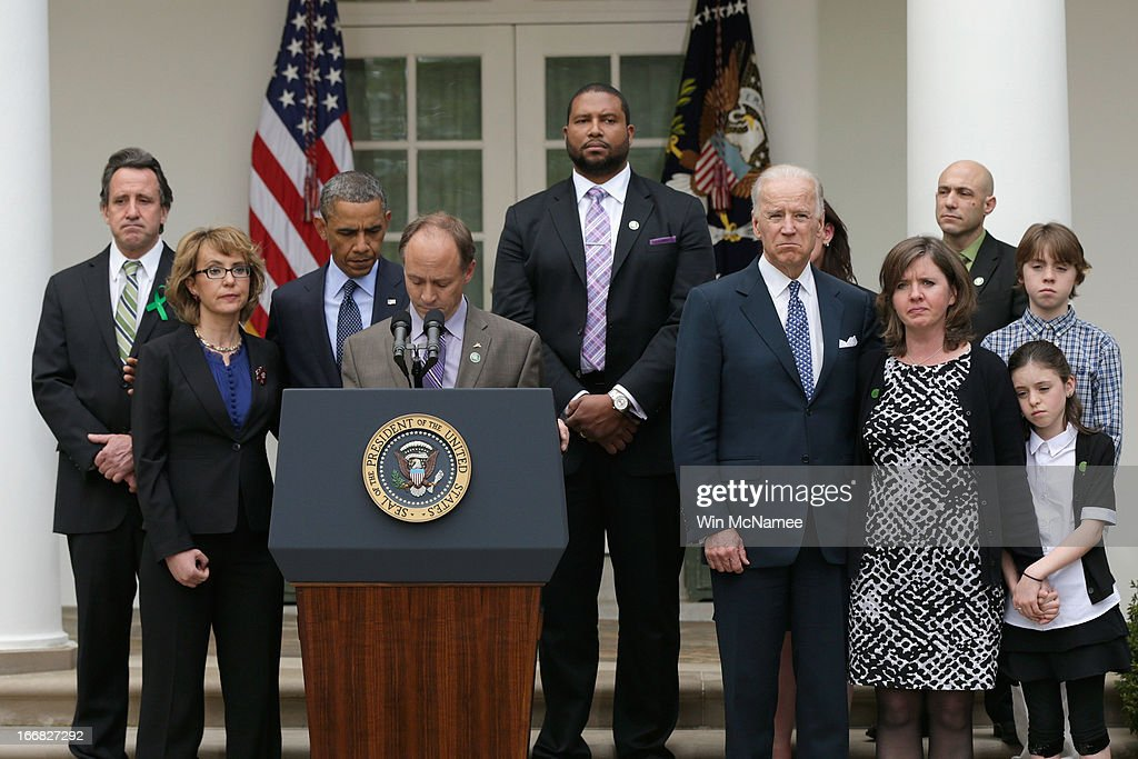 Father of Sandy Hook Elementary School shooting victim, Mark Barden introduces U.S. President <a gi-track='captionPersonalityLinkClicked' href=/galleries/search?phrase=Barack+Obama&family=editorial&specificpeople=203260 ng-click='$event.stopPropagation()'>Barack Obama</a> (3L) as former U.S. Rep. <a gi-track='captionPersonalityLinkClicked' href=/galleries/search?phrase=Gabrielle+Giffords&family=editorial&specificpeople=6961081 ng-click='$event.stopPropagation()'>Gabrielle Giffords</a> (2L), U.S. Vice President Joe Biden (5R) and family members of Newtown, CT shooting victims look on in the Rose Garden of the White House on April 17, 2013 in Washington, DC. Earlier today the Senate defeated a bi-partisan measure to expand background checks for gun sales.